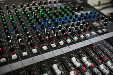 Hand on a Mixing Desk Fader in Television Gallery,