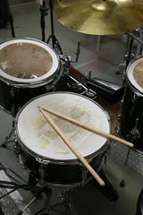 Drum set in training room. Music equipment in training room.