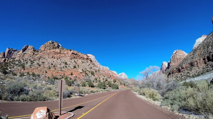 POV road trip driving desert landscape vehicle Mountain Pass snow Zion Utah USA