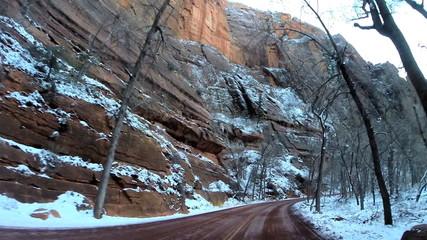 POV vehicle road trip winter valley sandstone cliffs  Zion National Park Utah USA
