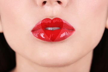 Love concept. Sexy lips with heart shape paint, closeup