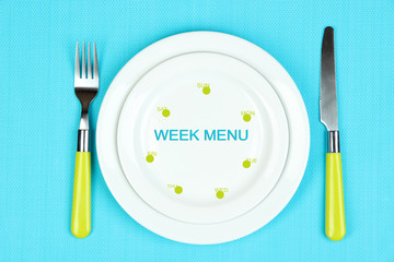 Plate with text Week Menu, fork and knife