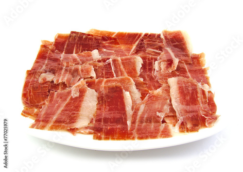 Staande foto Assortiment Serrano ham slices on a white dish. Jabugo. Spanish tapa.
