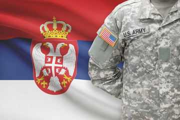 American soldier with flag on background - Serbia