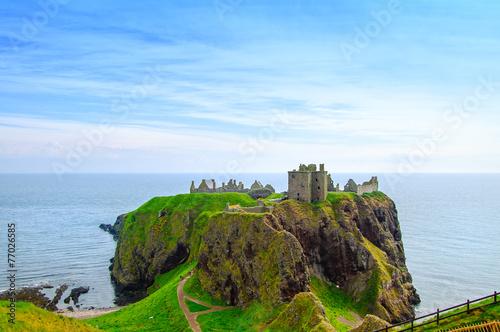 Leinwanddruck Bild Dunnottar scottish medieval fortress or castle. Highlands of Sco