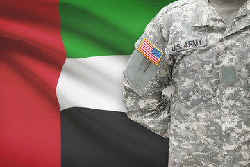 American soldier with flag on background - United Arab Emirates