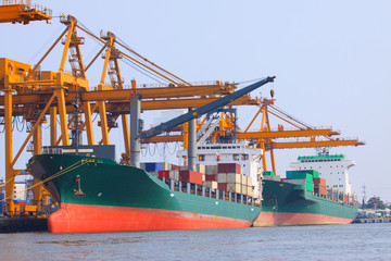 commercial ship with container on shipping port for import expor