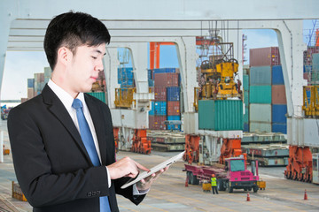 Business man using tablet to handle export and import Container