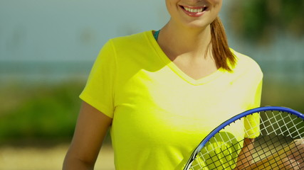 Smiling Caucasian Girl Promoting  Active Tennis Lifestyle