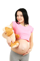 Beautiful young pregnant with baby toy isolated on white