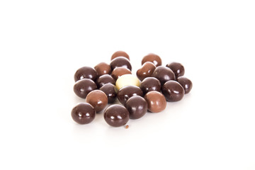 Chocolate balls on white background