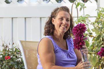 Woman with Spina Bifida relaxing in garden patio