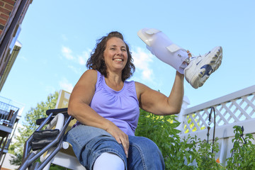 Woman with Spina Bifida holding up new leg brace