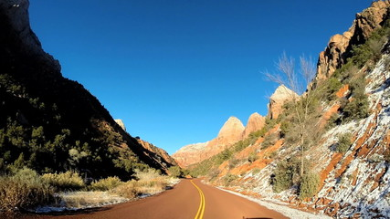 POV road trip driving desert snow landscape extreme climate snow Zion USA