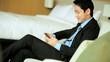 Ethnic Male Business Advisor Travel Hotel Room Relaxation Smart Phone