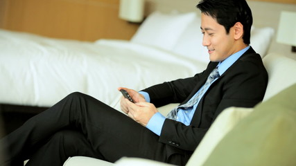 Ethnic Male Business Advisor Travel Hotel Room Relaxation Smart Phone