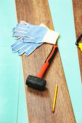 Carpenter tools on new laminate floor