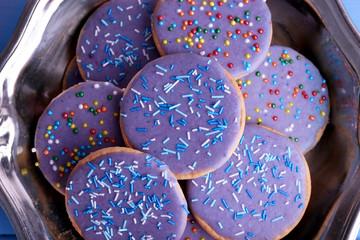 Group of glazed cookies in metal bowl