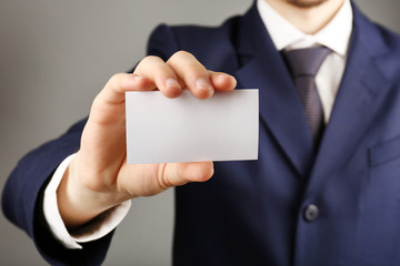 Businessman with business card, close-up