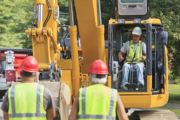 Heavy construction equipment operator in excavator