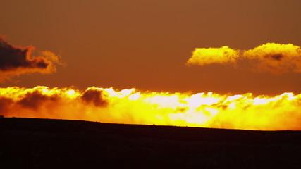 Sunrise motion cloudscape desert landscape orange colour, USA, RED EPIC