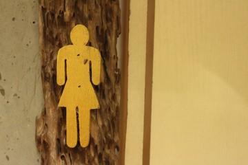 women toilet vintage label on a wooden background.