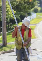 Construction supervisor using surveying rod