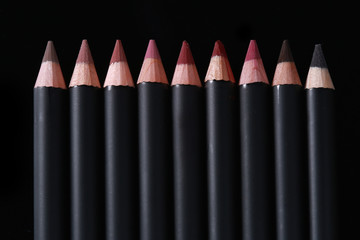 Lip Liner Pencils on Black Background