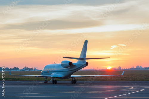 Fotobehang Vliegtuig Business jet on the apron of aircraft. Dawn at airport