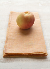 Apricot fruit on a yellow napkin placemat