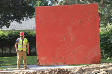 Construction worker standing beside shoring
