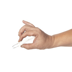 hand using a small tweezers