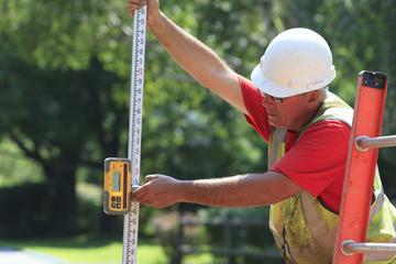 Construction supervisor using electronic surveying rod