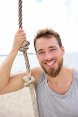 Fitness people portrait - healthy man with rope