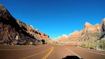 POV vehicle road drive winter snow blue sky rock terrain Zion National Park Utah
