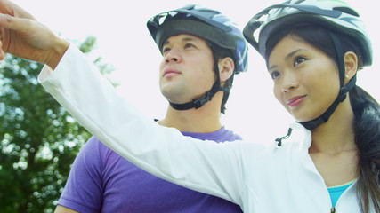 Healthy Young Ethnic Couple Cycling Together