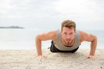 Push-up crossfit man fitness training on beach