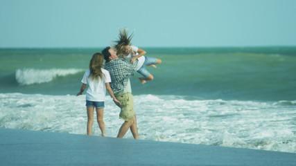 Caucasian Family Casual Clothing Enjoying Summer Beach Walking