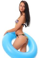 female in bikini holding swimming ring