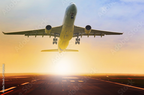 passenger jet plane take off fron airport runway with beautiful - 77043196