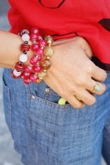 Women wearing bracelet and jewelry with jeans.