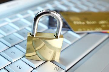 credit card and padlock on keyboard