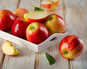 Fresh ripe apples  in a  wooden white box .