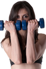 Young athletic woman holding a dumbbells