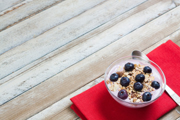 Yogurt with blueberries and muesli, free space on top left