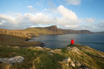 Man trekking through Scottish Highland seascape