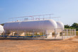 Natural Gas storage tanks in industrial plant. - 77046516