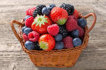 basket with fresh seasonal berries, close-up