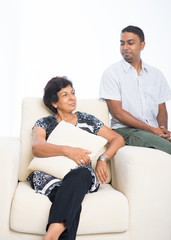 Asian Indian family, adult son having conversation with senior m