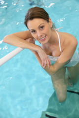 Portrait of beautiful woman in swimming-pool